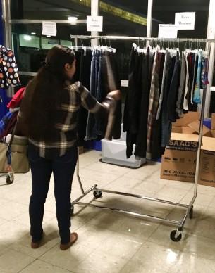 A student at Framingham ESL Plus Shops for Clothing